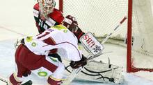 Team Canada's goalkeeper Jeff Deslauriers (L) is challenged by Tomas Kurka of Sparta Prague during their ice hockey match at the Spengler Cup tournament in the Swiss mountain resort of Davos December 29, 2010. (ARND WIEGMANN/REUTERS)