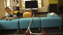 A kick scooter awaits a rider at the headquarters of Box.net, an online file sharing and Cloud content management service for enterprise companies, in Menlo Park, Calif., Feb. 5, 2013. Startups often thrive on a lack of rules and boundaries. But experts say that as they make the transition from a handful of people in a room to sizeable businesses, the hazards of operating without manual grow exponentially. (ROBERT GALBRAITH/REUTERS)