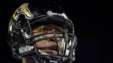 Hamilton Tiger-Cats quarterback Henry Burris waits to get back on the field against the Saskatchewan Roughriders during the second half of the CFL's 101st Grey Cup championship football game in Regina, Saskatchewan November 24, 2013. Burris, who becomes a free-agent this summer, says he wants to stay in Hamilton. (MARK BLINCH/REUTERS)