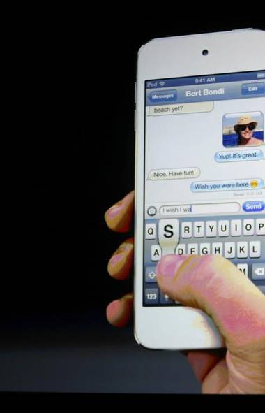 """""""The iPhone 5 is the iPhone we've wanted since 2010, adding long-overdue upgrades like a larger screen and faster 4G LTE in a razor-sharp new design. This is the iPhone, rebooted,"""" wrote Scott Stein at CNET, a technology website. """"The new design is flat-out lovely, both to look at and to hold."""" (BECK DIEFENBACH/REUTERS)"""