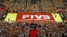 Performers perform around the FIVB flag during the opening ceremony of the FIVB Volleyball Men's World Championship (KACPER PEMPEL/REUTERS)