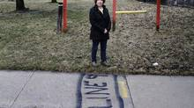 Jan Morrisey, a member of the Bayview Cummer Neighbourhood Association, stands by a sidewalk theat marks the path of a pipeline running under her Toronto neighbourhood on April 10, 2013. (FERNANDO MORALES/THE GLOBE AND MAIL)