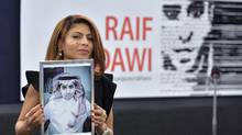 Ensaf Haidar holds a picture of her husband, Raif Badawi, after accepting the European Parliament's Sakharov human rights prize on behalf of her husband in Strasbourg on Dec. 16, 2015. (PATRICK HERTZOG/AFP/Getty Images)