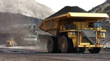 A truck carries 250 tons of coal to the surface of the Spring Creek mine near Decker, Mont. (Matthew Brown/Associated Press)