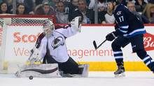 Winnipeg Jets left wing Adam Lowry watches as Colorado Avalanche goalie Calvin Pickard makes a pad save during the first period at the MTS Centre in Winnipeg on Saturday, March 4, 2017. (Bruce Fedyck/USA Today Sports)