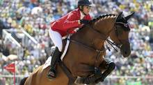 Amy Millar rides her horse, Heros, during the team jumping final at the Rio Olympics. (TONY GENTILE/REUTERS)