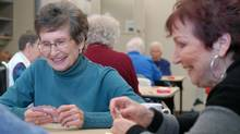 Kitty Esau, left, and Jean Gordon play a hand of Whist with their friends at the Langley Seniors Recreation and Resource Centre in Langley, B.C. (John Morstad for The Globe and Mail)