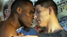"""Adonis """"Superman"""" Stevenson, left, from Montreal, faces off with Jesus """"El Martillo"""" Gonzales, from Phoenix, at the weigh-in for their upcoming IBF Super middleweight elimination fight Friday, February 17, 2012 in Montreal. THE CANADIAN PRESS/Ryan Remiorz (Ryan Remiorz/CP)"""