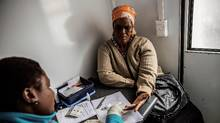 A South African woman gets tested for HIV by an health worker working with Doctors Without Borders (MSF) at a mobile clinic in Eshowe. (GIANLUIGI GUERCIA/AFP/Getty Images)