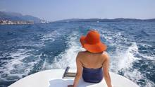 woman relaxing on a yacht (Jovanmandic/Getty Images/iStockphoto)