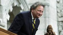 Ukrainian-Canadian businessman Eugene Melnyk, owner of the NHL's Ottawa Senators, stands in the visitors gallery as he is recognized in the House of Commons at the conclusion of Question Period on Parliament Hill, in Ottawa Tuesday, March 4, 2014. (FRED CHARTRAND/THE CANADIAN PRESS)