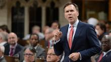 Minister of Finance Bill Morneau responds to a question during question period in the House of Commons on Parliament Hill in Ottawa on Tuesday, Oct. 4, 2016. (Sean Kilpatrick/THE CANADIAN PRESS)
