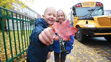 Twins Keenan Ash, left, and William Kees Bouman started Grade 1 at Rawlinson Community School at age 5 1/2 . (Glenn Lowson For The Globe and Mail)