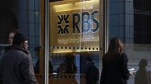 People walk past a Royal Bank of Scotland (RBS) building in the City of London in this January 12, 2012 file photo. (STEFAN WERMUTH/REUTERS)
