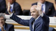 Gianni Infantino acknowledges his colleagues' applause after he is named the new president of FIFA in Zurich, Switzerland, on Friday. (Michael Probst/AP)