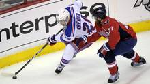 New York Rangers left wing Chris Kreider (20) skates past Washington Capitals defenseman Karl Alzner (27) during the second period of Game 3 of their NHL hockey Stanley Cup second-round playoff series. (Associated Press)