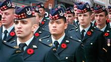Infantry Soldiers of the Seaforth Highlanders of Canada mark Remembrance Day in downtown Vancouver on Nov. 11, 2013. (Katelyn Verstraten/The Globe and Mail)
