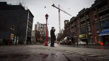 Building cranes in Chinatown have prompted concerned residents to seek a moratorium on development. (DARRYL DYCK/THE GLOBE AND MAIL)