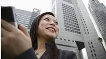 Smiling businesswoman (Jupiterimages/(C) 2007 Thinkstock Images)