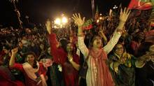 """Supporters of chairman of the Pakistan Tehreek-e-Insaf (PTI) political party Imran Khan, a former international cricketer, cheer while listening to him speak during what has been dubbed a """"freedom march"""" in Islamabad August 20, 2014. (FAISAL MAHMOOD/REUTERS)"""