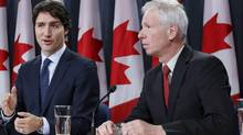 Prime Minister Justin Trudeau and Foreign Minister Stéphane Dion: Saudi officials painted the deal to supply Riyadh with LAVS as a goodwill gesture. (Chris Wattie/Reuters)