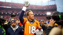 Denver Broncos quarterback Peyton Manning waves to the crowd after the AFC Championship football game against the New England Patriots at Sports Authority Field at Mile High on Jan. 24, 2016. (USA TODAY SPORTS/USA Today Sports)