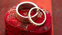 Rings on a gift box. (Jupiterimages/Getty Images)
