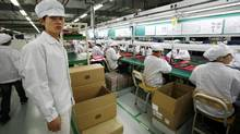 A Foxconn plant in China; The company, like other manufacturers in China, is being dragged on to a wage superhighway in which manual labourers are enjoying inflation-busting pay increases of 20 per cent a year. (BOBBY YIP/Bobby Yip/Reuters)