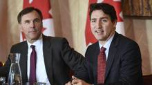 Prime Minister Justin Trudeau and Bill Morneau, Minister of Finance, met with members of the banking and finance community during a morning meeting in Toronto on Nov. 14, 2016. Legislation to create a $35-billion Canada Infrastructure Bank is scheduled to receive just one day of dedicated committee scrutiny. (Fred Lum/The Globe and Mail)