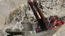 A mining shovel loads a mining truck at the Los Bronces copper mine, some 65 km (40 miles) northeast of Santiago city and 3500 meters above sea level, in this March 12, 2008 file picture. Anglo American and copper giant Codelco ended a bruising 10-month long dispute on August 23, 2012. (IVAN ALVARADO/REUTERS)