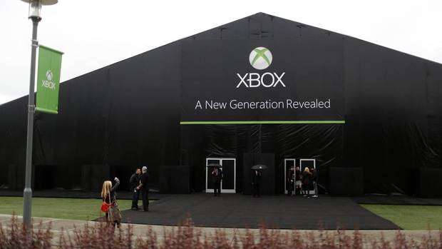 A woman takes pictures of the event tent set up for a press event unveiling Microsoft's new Xbox in Redmond, Washington May 21, 2013. (NICK ADAMS/REUTERS)