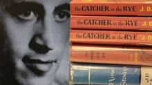 Author J.D. Salinger, who died in 1951, with copies of his classic novel The Catcher in the Rye. (AMY SANCETTA/AP)