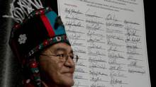 Chief John Ridsdale of the Wet'Suwet'en is seen during a signing ceremony Thursday as first nations leaders sign the Save the Fraser Declaration in downtown Vancouver. The declaration is an indigenous law banning tar sands and pipelines and tankers from crossing British Columbia. (Jonathan Hayward/THE CANADIAN PRESS)