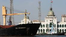 A ship navigates in the Suez Canal in 2008 (CRIS BOURONCLE)