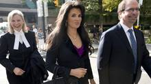 Tali'ah Aquilini, centre, leaves B.C. Supreme Court in Vancouver on Sept., 9, 2013. (Jonathan Hayward/The Canadian Press)