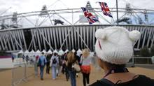 Performers arrive at the Olympic Stadium for opening ceremony rehearsals for the 2012 Summer Olympics, Sunday, July 15, 2012, in London. (Associated Press)