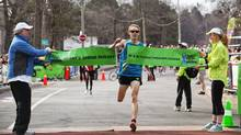 Toronto: April 3, 2010. Runner Eric Gillis of Guelph, Ontario, wins the 8 km Harry's Spring Run-Off to fight prostate cancer, held in High Park. (Della Rollins For The Globe and Mail)