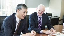 Li Fanrong, CEO of CNOOC Ltd., and interim Nexen Inc. CEO Kevin Reinhart last year, just after the Chinese state-owned CNOOC took control of Calgary oil and gas producer Nexen. Proposed new rules could make the purchase process more difficult for foreign state-owned enterprises. (CHRIS BOLIN FOR THE GLOBE AND MAIL)
