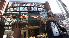 A vendor offers programs outside the stadium prior to Game 1 of the World Series between the Detroit Tigers and the San Francisco Giants in San Francisco, October 24, 2012. (Reuters)