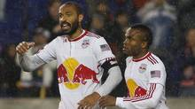 Thierry Henry #14 of the New York Red Bulls celebrates his second half goal with teammate Dane Richards #19 against the San Jose Earthquakes on April 16, 2011 at Red Bull Arena in Harrison, New Jersey. The Red Bulls defeated the Earthquakes 3-0. (Photo by Mike Stobe/Getty Images for New York Red Bulls) (Mike Stobe/Getty Images)