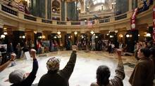 Protesters in February take part in a Solidarity Sing-Along, a daily protest at the state Capitol in Madison, Wis., after Republican Governor Scott Walker declared war on public sector unions. (Michael P. King/Associated Press)