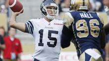 Toronto Argonauts' quarterback Ricky Ray (15) throws against Alex Hall (96) and the Winnipeg Blue Bombers during the first half of their CFL game at Investors Group Field in Winnipeg Friday, July 19, 2013. (John Woods/THE CANADIAN PRESS)
