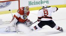 A shot by New Jersey Devils left wing Taylor Hall (9) deflects off Florida Panthers goalie James Reimer (34) during overtime of an NHL hockey game, Thursday, Nov. 3, 2016, in Sunrise, Fla. (Alan Diaz/THE ASSOCIATED PRESS)