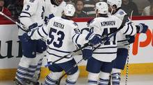 Toronto Maple Leafs' Nazem Kadri (2nd left) is congratulated by team mates on his goal over Montreal Canadiens goalie Carey Price (not pictured) during the first period of their NHL hockey game in Montreal January 19, 2013. (CHRISTINNE MUSCHI/REUTERS)