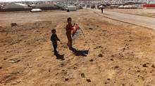 Children play outside the Zaatari refugee camp in Jordan on Jan. 24, 2014. (Campbell Clark/The Globe and Mail)