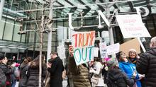 Protesters demonstrate in front of the Trump International Hotel and Tower in Vancouver during the hotel's opening day on Feb. 28, 2017. (STEPHANIE LAMY/AFP/Getty Images)