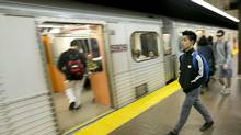 Commuters board a TTC subway at Kennedy Station in Scarborough. (KEVIN VAN PAASSEN/THE GLOBE AND MAIL)