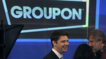 Groupon chief executive officer Andrew Mason, left, prepares for the opening bell ceremony celebrating his company's IPO on Nasdaq Nov. 4, 2011. (BRENDAN MCDERMID/REUTERS)