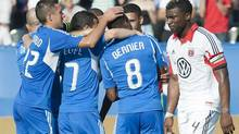 D.C. United's Brandon McDonald, right, walks by as players from the Montreal Impact celebrate after Patrice Bernier scored during second half MLS soccer action in Montreal, Saturday, August 25, 2012. (Graham Hughes/THE CANADIAN PRESS)