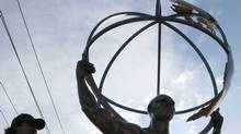 Atlas, an approximately 700 pound, $200,000.00 copper sculpture that was stolen from its perch high atop Highway 400 in Toronto, is put back in place in December of 2006. (Tory Zimmerman)